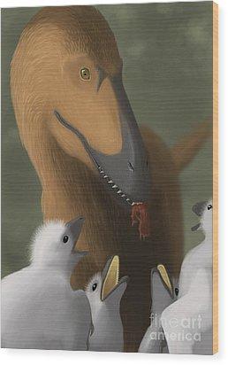 Deinonychus Dinosaur Feeding Its Young Wood Print by Michele Dessi