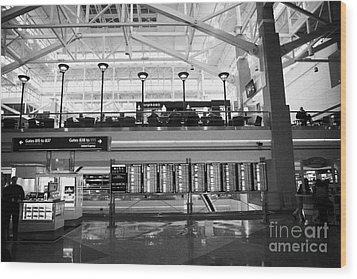 departures board at concourse b Denver International Airport Colorado USA Wood Print by Joe Fox
