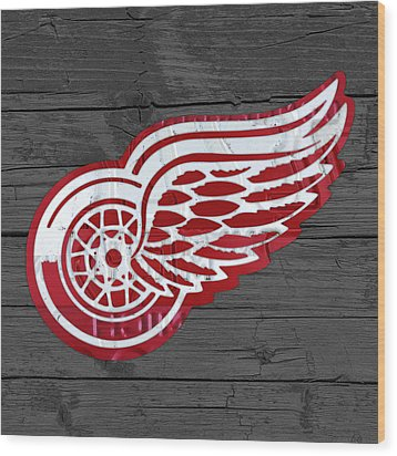 Detroit Red Wings Recycled Vintage Michigan License Plate Fan Art On Distressed Wood Wood Print by Design Turnpike