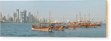 Dhows On Parade In Doha Wood Print by Paul Cowan