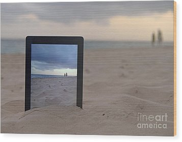 Digital Tablet In Sand On Beach Wood Print by Sami Sarkis