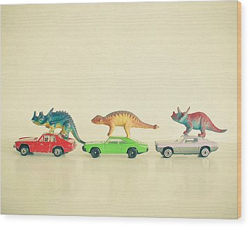 Dinosaurs Ride Cars Wood Print by Cassia Beck