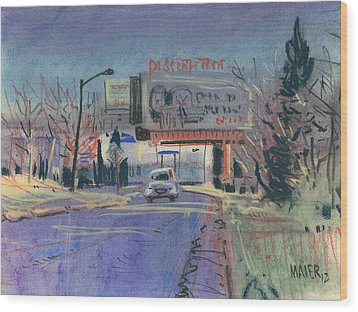 Discount Tire Wood Print by Donald Maier