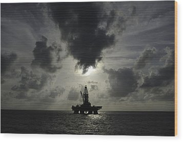 Distant Offshore Oil Rig Wood Print by Bradford Martin