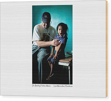 Doctor Examines Honduran Girl Wood Print by Tina Manley