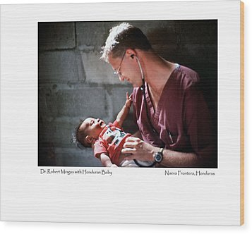 Doctor With Honduran Baby Wood Print