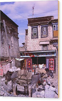 Donkeys In Jokhang Bazaar Wood Print by Anna Lisa Yoder