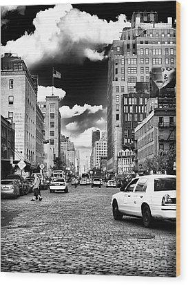 Downtown Cab Ride Wood Print by John Rizzuto