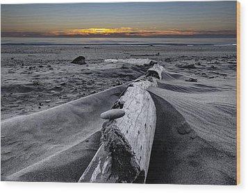 Driftwood In The Sand Wood Print by Debra and Dave Vanderlaan