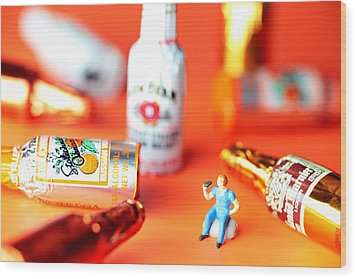 Drinking Among Liquor Filled Chocolate Bottles Wood Print by Paul Ge