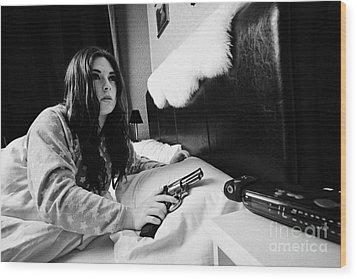 Early Twenties Woman Waking Holding Handgun In Bed In A Bedroom Wood Print by Joe Fox