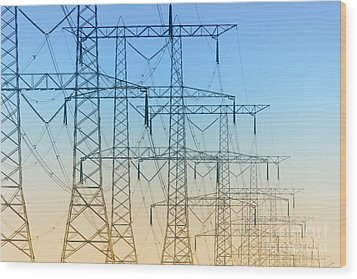 Electricity Pylons Standing In A Row Wood Print