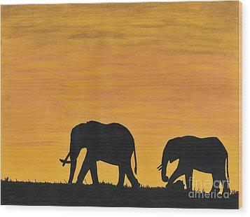 Elephants - At - Sunset Wood Print