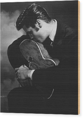 Elvis Presley Kisses Guitar Wood Print by Retro Images Archive
