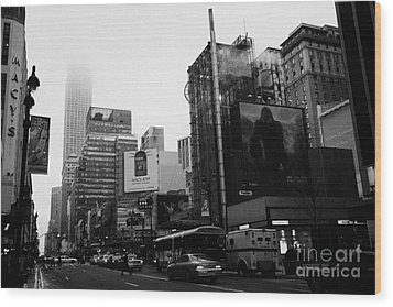 empire state building shrouded in mist from west 34th Street and 7th Avenue new york city usa Wood Print by Joe Fox