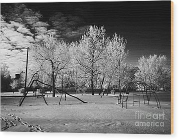 empty childrens playground with hoar frost covered trees on street in small rural village of Forget  Wood Print by Joe Fox