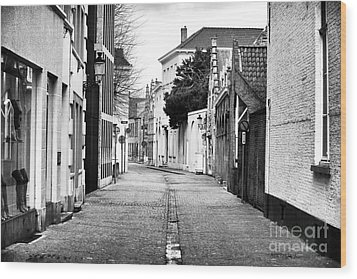 Empty Street In Bruges Wood Print by John Rizzuto