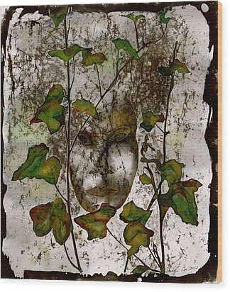 Face In The Garden Wood Print by Carolyn Doe