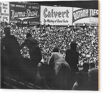Fans In The Bleachers During A Baseball Game At Yankee Stadium Wood Print by Underwood Archives