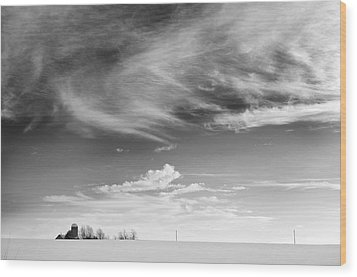 Farm In The Distance In A Snowy Field Wood Print by Patrick LaRoque