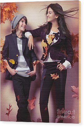 Fashionably Dressed Boy And Teenage Girl Under Falling Autumn Le Wood Print by Oleksiy Maksymenko
