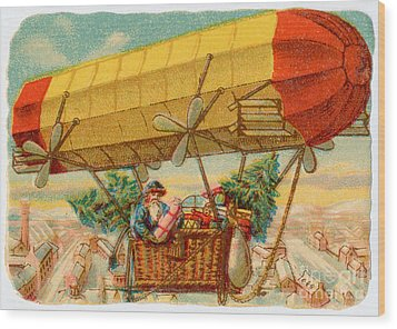 Father Christmas In Airship Wood Print by Mary Evans