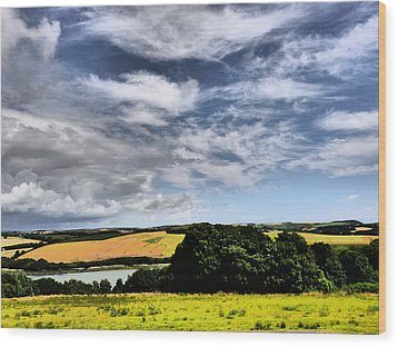 Feather Clouds Over Fields Wood Print