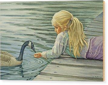 Feeding The Canada Goose Wood Print by Paul Krapf