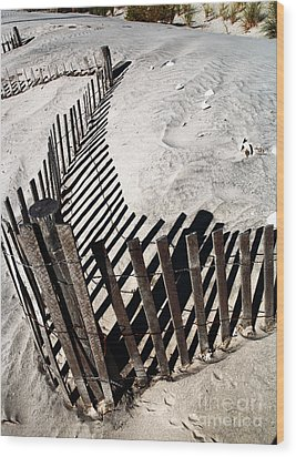 Fence Shadows Wood Print by John Rizzuto