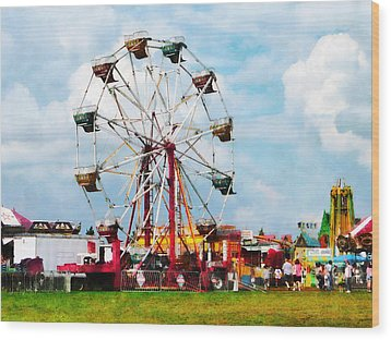 Ferris Wheel Against Blue Sky Wood Print by Susan Savad