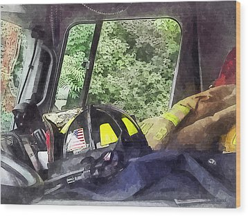 Firemen - Helmet Inside Cab Of Fire Truck Wood Print by Susan Savad