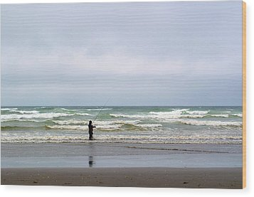 Fisherman Bracing The Weather Wood Print by Tikvah's Hope
