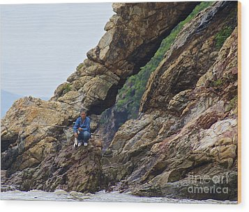 Fisherman On Rocks  Wood Print