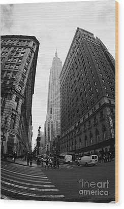 fisheye shot View of the empire state building from West 34th Street and Broadway new york usa Wood Print by Joe Fox