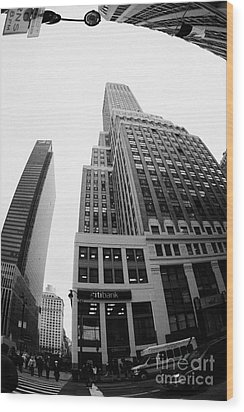 fisheye view of the Nelson Tower and 1 penn plaza in the background from junction of 34th street and Wood Print by Joe Fox