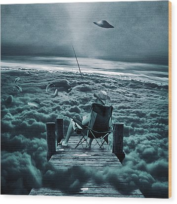 Fishing Above The Clouds Wood Print