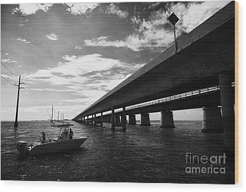 Fishing Boat Beneath New Seven Mile Bridge In Marathon In The Florida Keys Wood Print by Joe Fox
