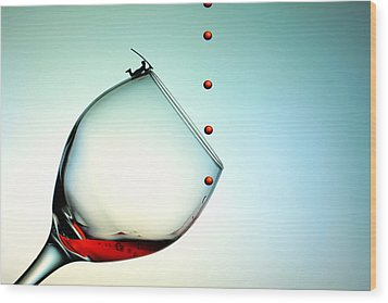 Fishing On A Glass Cup With Red Wine Droplets Little People On Food Wood Print