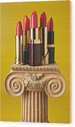 Five Red Lipstick Tubes On Pedestal Wood Print by Garry Gay