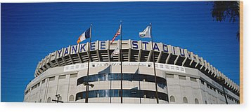 Flags In Front Of A Stadium, Yankee Wood Print