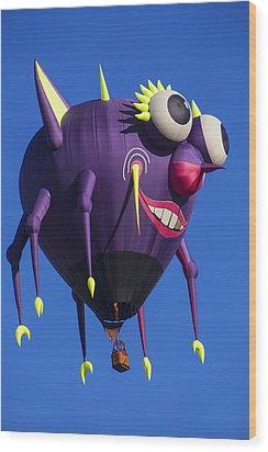 Floating Purple People Eater Wood Print by Garry Gay