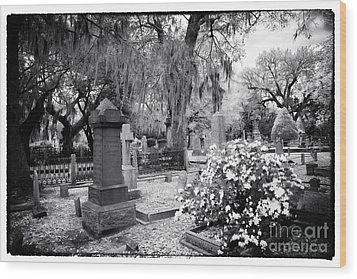 Flowers By The Grave Wood Print by John Rizzuto