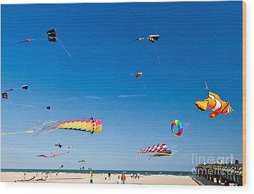 Flying Kites At St Augustine Beach Pier Wood Print by Michelle Wiarda
