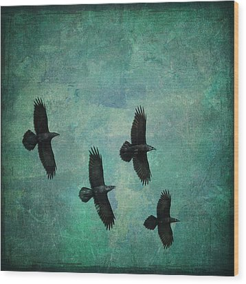 Wood Print featuring the photograph Flying Ravens by Peggy Collins