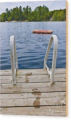 Footprints On Dock At Summer Lake Wood Print by Elena Elisseeva
