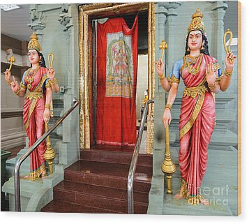 Four-armed Deities Guard The Inner Sanctum Of A Hindu Temple Wood Print by David Hill