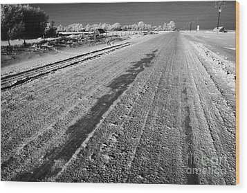 frozen salt and grit covered rural small road in Forget Saskatchewan Canada Wood Print by Joe Fox