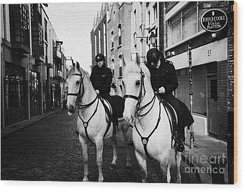 Garda Siochana Mounted Police On Horseback Taking Notes In Temple Bar Dublin Republic Of Ireland Wood Print by Joe Fox