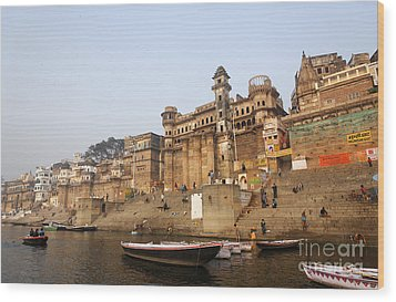 Ghats And Boats On The River Ganges At Varanasi In India Wood Print by Robert Preston