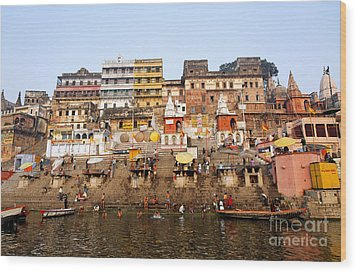Ghats In The River Ganges At Varanasi In India Wood Print by Robert Preston